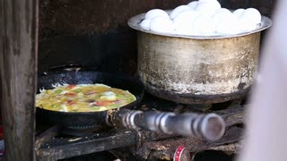 Local Indian food being prepared on stove at street stand in Jodhpur.
