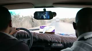 Local people driving in car and watching video of local singer