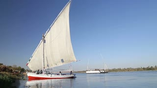 Local people with tourists on felucca