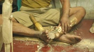 Local sculptor working in his shop in Hikkaduwa, Sri Lanka.