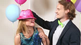 Love couple dancing in photo booth
