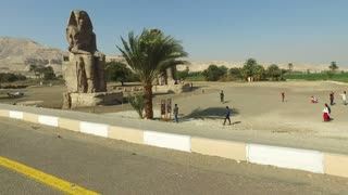 LUXOR, EGYPT - FEBRUARY 10, 2016: Pharaoh Amenhotep III's Sitting Colossi of Memnon statues at Luxor, West Bank