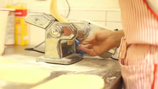 Making pasta with pasta machine