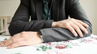 Male hands on restaurant table