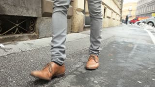 Male shoes walking down the street