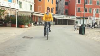 Man cycling on road in Rovinj, Croatia.