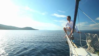 Man enjoying sailing trip on boat