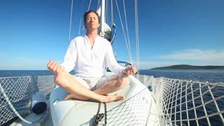 Man enjoying sailing trip on boat