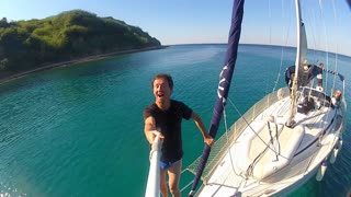 man filming panorama on sailing boat