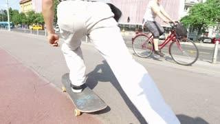 Man legs on skateboard