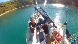 man on sailing boat in the mediterranean doing a 360 degree pan