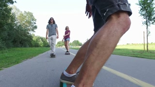 Man riding longboard with friends