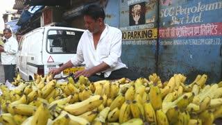 Man selling bananas on ambulant stand on the streets of Mumbai, India.