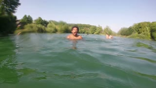 Man swimming underwater in river