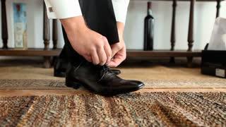 Man tying his black shoelaces