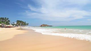 MIRISSA, SRI LANKA - MARCH 2014: View of beautiful sandy beach and clear water in Mirissa, one of Sri Lanka�۪s busiest tourist beaches.