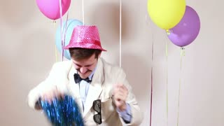 Moustache man with pink hat dancing in photo booth