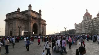 MUMBAI, INDIA - 10 JANUARY 2015: Indian citizens and tourists in front of Gateway to India in Mumbai.