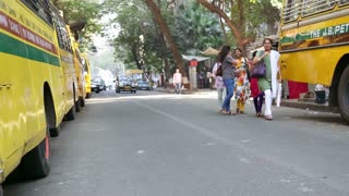 MUMBAI, INDIA - 10 JANUARY 2015: People and traffic on the street of Mumbai, front view.