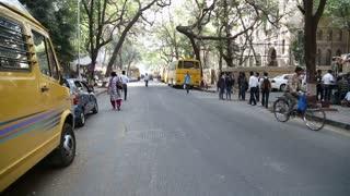 MUMBAI, INDIA - 10 JANUARY 2015: People and traffic on the street of Mumbai.