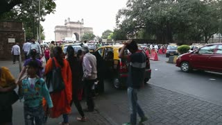 MUMBAI, INDIA - 10 JANUARY 2015: Taxi waiting in a traffic jam on a busy street to Gateway to India.