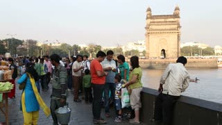 MUMBAI, INDIA - 10 JANUARY 2015: Tourists at the dock, with view on the Gateway to India, in Mumbai.