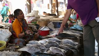 MUMBAI, INDIA - 11 JANUARY 2015: Indian woman selling fish at a market in Mumbai.