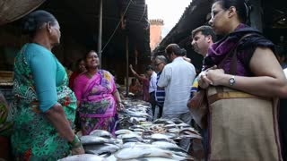 MUMBAI, INDIA - 11 JANUARY 2015: Indian women selling fish at a market in Mumbai.