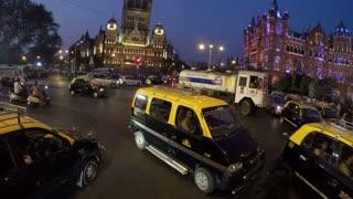 MUMBAI, INDIA - 11 JANUARY 2015: Traffic jam, with people passing, in Mumbai in night time.