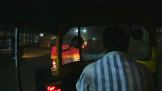 MUMBAI, INDIA - 12 JANUARY 2015: Fast motion at the back of a richshaw driving at night in the city.