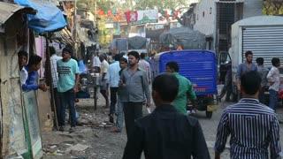 MUMBAI, INDIA - 12 JANUARY 2015: People and vehicles passing down the street in Mumbai.