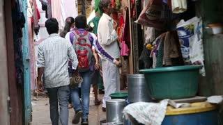 MUMBAI, INDIA - 12 JANUARY 2015: People passing through a narrow street in Mumbai.