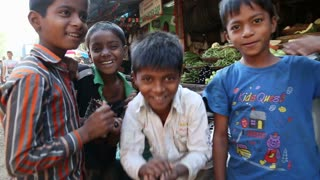 MUMBAI, INDIA - 12 JANUARY 2015: Portrait of cheerful Indian boys at a street in Mumbai.