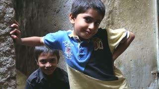 MUMBAI, INDIA - 12 JANUARY 2015: Portrait of three cheerful Indian boys in Mumbai.