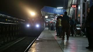 MUMBAI, INDIA - 12 JANUARY 2015: Train arriving at the train station in the night time in Mumbai.