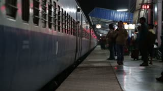 MUMBAI, INDIA - 12 JANUARY 2015: Travelers exciting the train in the night time in Mumbai.