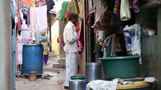 MUMBAI, INDIA - 12 JANUARY 2015: Woman passing through a street in Mumbai.