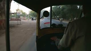 MUMBAI, INDIA - 14 JANUARY 2015: Inside view on man driving rickshaw through the road in Mumbai.