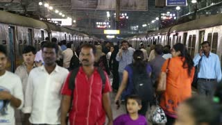 MUMBAI, INDIA - 14 JANUARY 2015: People at the crowded train station in Mumbai in the night time.