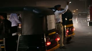 MUMBAI, INDIA - 14 JANUARY 2015: Policeman controlling traffic in a busy street in Mumbai.