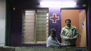 MUMBAI, INDIA - 14 JANUARY 2015: Portrait of two Indian medicine men in front of clinic.