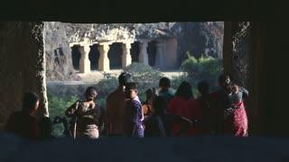 MUMBAI, INDIA - 14 JANUARY 2015: View through wall gap on tourists in Aurangabad caves.