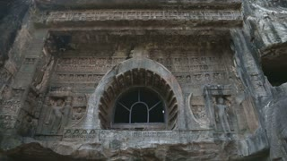 MUMBAI, INDIA - 15 JANUARY 2015: One of entrances to Aurangabad caves with tourists in front.
