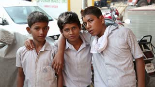MUMBAI, INDIA - 16 JANUARY 2015: Portrait of three Indian boys at the street in Mumbai.