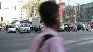 MUMBAI, INDIA - 16 JANUARY 2015: Vehicles and people passing down the street in Mumbai.