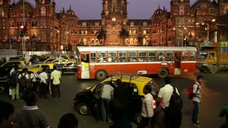 MUMBAI, INDIA - 17 JANUARY 2015: Busy traffic in front of Chhatrapati Shivaji Terminus, train terminal in Mumbai.