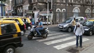 MUMBAI, INDIA - 17 JANUARY 2015: Crossroads of busy street in Mumbai.