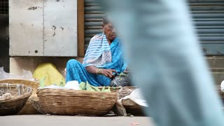 MUMBAI, INDIA - 17 JANUARY 2015: Indian woman selling vegetables at the street floor in Mumbai.