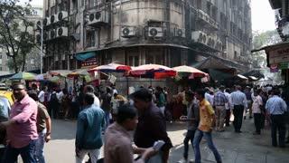 MUMBAI, INDIA - 17 JANUARY 2015: Socialist building in a busy street in Mumbai.