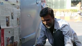 MUMBAI, INDIA - 7 JANUARY 2015: Local man redoing color on car on the street of Mumbai.